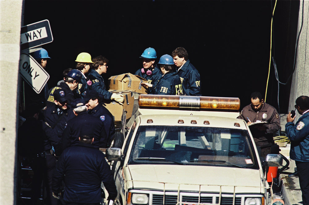 . Members of the FBI gather materials from an underground parking garage at the World Trade Center in New York on March 2, 1993.  The blast rocked the twin towers complex, killing 6 and injuring hundreds.  Investigation clean up continues. (AP Photo/Alex Brandon)