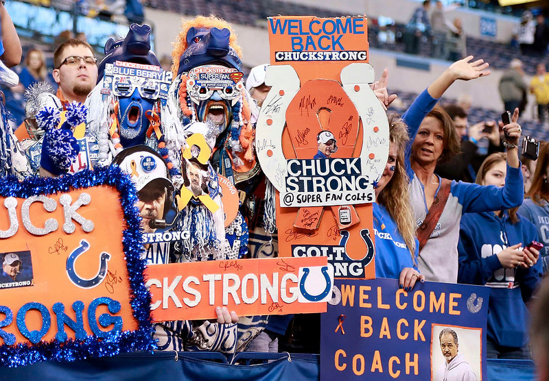 . Indianapolis Colts fans hold up signs prior to the start of an NFL football game against the Houston Texans in Indianapolis, Indiana December 30, 2012.   REUTERS/Brent Smith