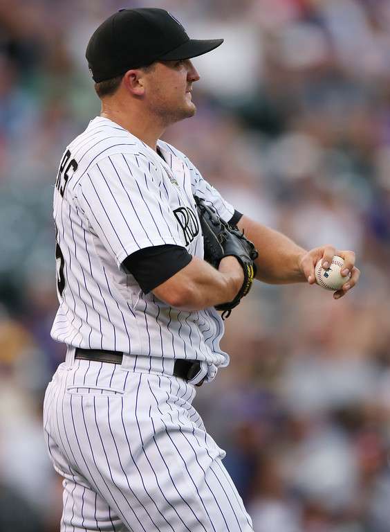 . Colorado Rockies relief pitcher Rex Brothers reacts after giving up back-to-back solo home runs to the Pittsburgh Pirates in the eighth inning of the Pirates\' 7-5 victory in a baseball game in Denver on Sunday, July 27, 2014. (AP Photo/David Zalubowski)