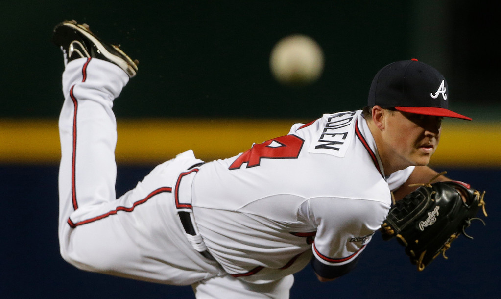 . Atlanta Braves starting pitcher Kris Medlen works against the Los Angeles Dodgers during Game 1 of the National League Divisional Series, Thursday, Oct. 3, 2013, in Atlanta. (AP Photo/David Goldman)