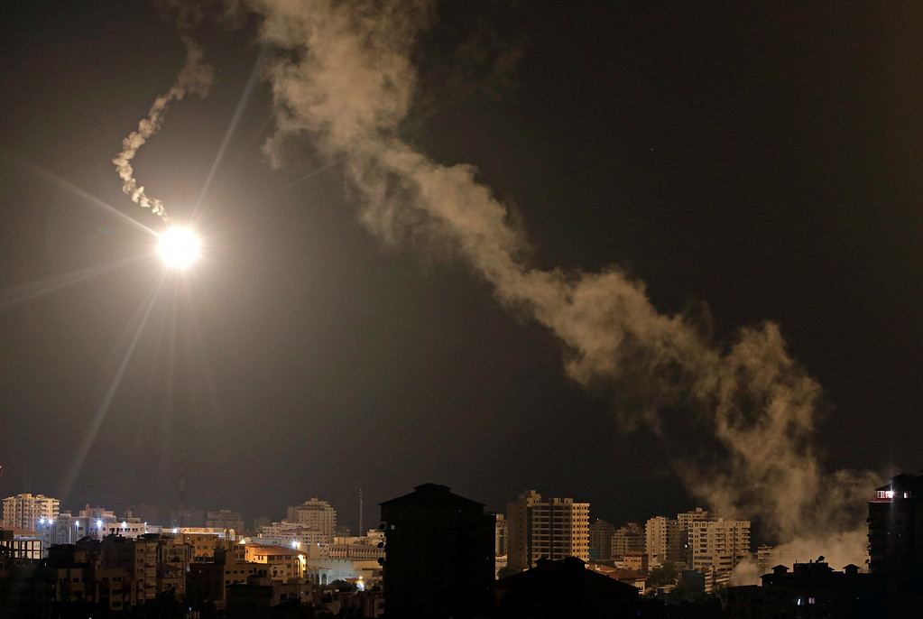 . Israeli forces\' flares light up the night sky  of Gaza City on early Tuesday, July 29, 2014. A truce between Israel and Hamas militants in Gaza remained elusive as diplomats sought to end the fighting at the start of the Eid al-Fitr holiday, marking the end of the Muslim holy month of Ramadan. (AP Photo/Khalil Hamra)