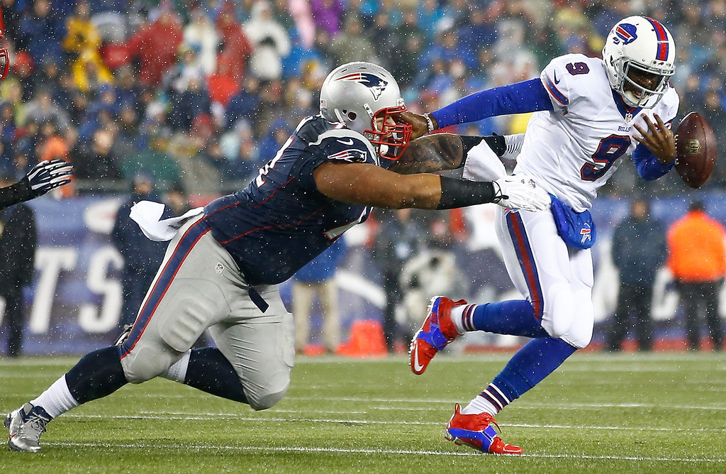 . Thad Lewis #9 of the Buffalo Bills fumbles the ball while being ran down by Sealver Siliga #71 of the New England Patriots in the first quarter during the game at Gillette Stadium on December 29, 2013 in Foxboro, Massachusetts.  (Photo by Jared Wickerham/Getty Images)