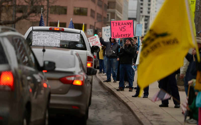 . People, opposed to future gun laws, line the sidewalks for a rally, March, 04, 2013, outside the Colorado State Capitol in Denver. (Photo By RJ Sangosti/The Denver Post)