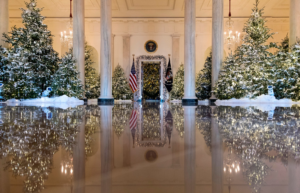 ". The Grand Foyer and Cross Hall are decorated with ""The Nutcracker Suite\"" theme during a media preview of the 2017 holiday decorations at the White House in Washington, Monday, Nov. 27, 2017. (AP Photo/Carolyn Kaster)"