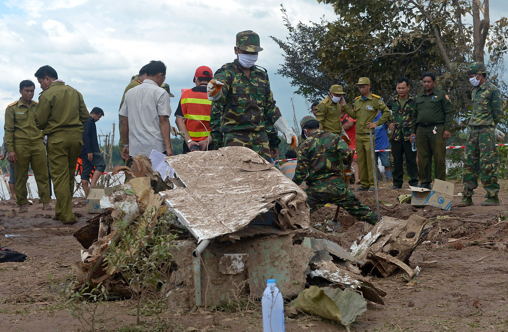 . Lao soldiers stand next to pieces from a Lao Airlines plane after it crashed into the Mekong river near Pakse town, on October 17, 2013.  AFP PHOTO / PORNCHAI  KITTIWONGSAKUL/AFP/Getty Images