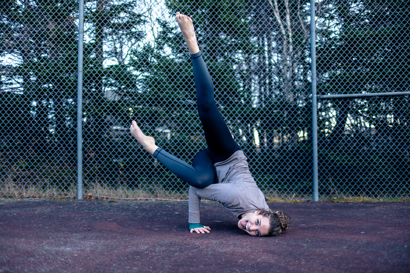 Sarah Yoga poses at Tennis Court