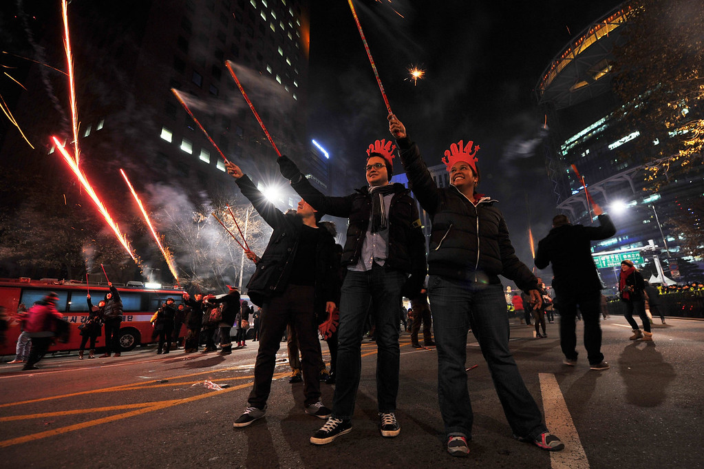 . People celebrate the New Year during a countdown event in front of the Bosingak Pavilion, in downtown Seoul, South Korea, on January 1, 2014.   WOOHAE CHO/AFP/Getty Images