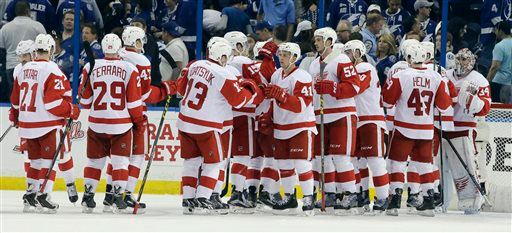 . Detroit Red Wings players line up to greet goalie Petr Mrazek, right, of the Czech Republic, after the Red Wings defeated the Tampa Bay Lightning 3-2 during Game 1 of an NHL hockey first-round playoff series Thursday, April 16, 2015, in Tampa, Fla. (AP Photo/Chris O\'Meara)