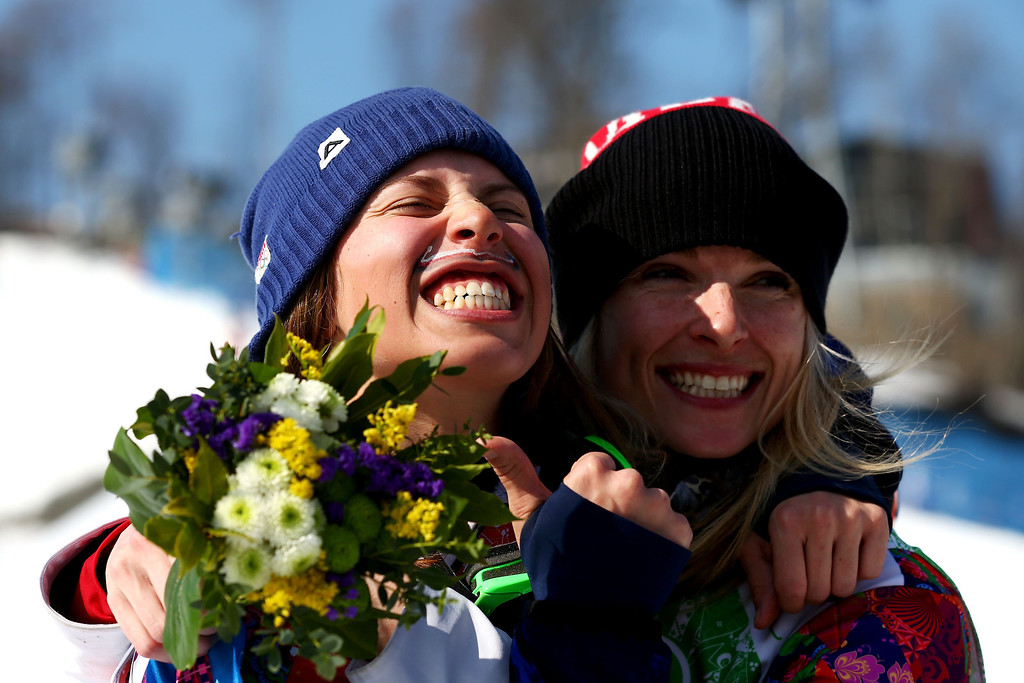 . Silver medalist Dominique Maltais of Canada (R) and gold medalist Eva Samkova of the Czech Republic celebrate during the flower ceremony for the Ladies\' Snowboard Cross Finals on day nine of the Sochi 2014 Winter Olympics at Rosa Khutor Extreme Park on February 16, 2014 in Sochi, Russia.  (Photo by Cameron Spencer/Getty Images)
