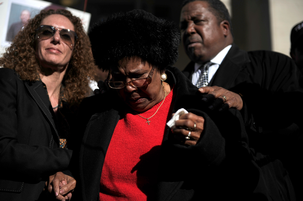 . Roxey Walton stands with supporters during a rally seeking justice for her son, who was killed during an altercation with deputies while being booked on charges of possession of drug paraphernalia in 2010. Denver Detention Center on Wednesday, March 12, 2014. (Photo By AAron Ontiveroz/ The Denver Post)