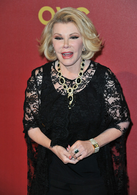 . Joan Rivers arrives at QVC Presents Red Carpet Style on Friday, Feb, 28, 2014 in Beverly Hills, Calif. (Photo by Richard Shotwell/Invision/AP)