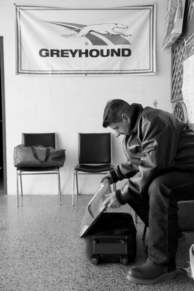 Minor James Miller Junior goes through his suitcase while at the Bus Depot on Broadway Avenue in Mattoon, Illinois on March 3, 2009.  Miller, a Montrose, Illinois native, has found residence in Odessa, Missouri with an old friend.  (Jay Grabiec)