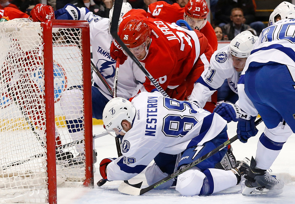 . Tampa Bay Lightning defenseman Nikita Nesterov (89) clears the puck from the goal line against the Detroit Red Wings in the second period of an NHL hockey game in Detroit Saturday, March 28, 2015. (AP Photo/Paul Sancya)