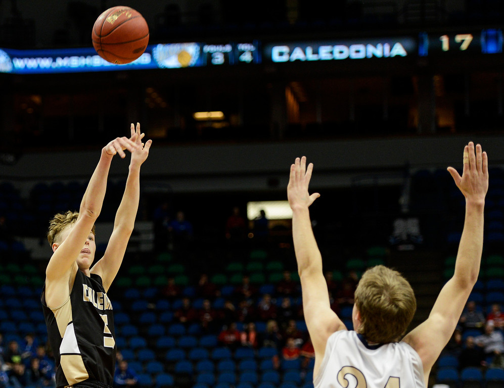 . Warriors guard Josh Nord, left, shoots, a 3-pointer during the first half. (Special to the Pioneer Press: Matt Mead)