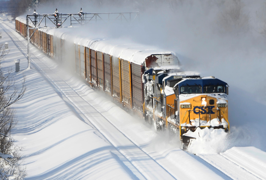 . A CSX freight train plows its way past the Cemetery Rd. overpass in Lancaster,  N.Y. Wednesday, Nov. 19, 2014. A lake-effect snow storm dumped over five feet of snow in areas across Western New York. Another two to three feet of snow is expected in the area, bringing snow totals to over 100 inches, almost a years\' worth of snow in three days.  (AP Photo/Gary Wiepert)