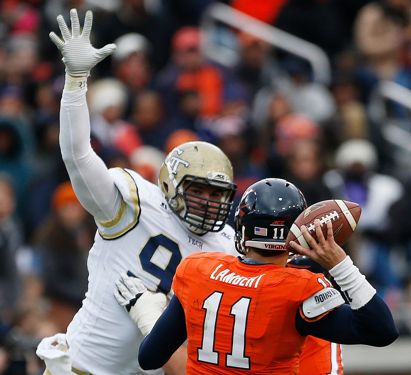 . Georgia Tech defensive lineman Adam Gotsis (96) defends against Virginia quarterback Greyson Lambert during the first half of an NCAA college football game, Saturday, Nov. 1, 2014, in Atlanta. (AP Photo/Mike Stewart)