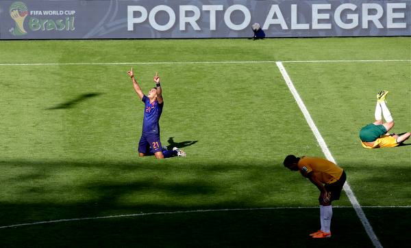 . Netherlands\' Memphis Depay, left, celebrates winning 3-2 after the group B World Cup soccer match between Australia and the Netherlands at the Estadio Beira-Rio in Porto Alegre, Brazil, Wednesday, June 18, 2014.  (AP Photo/Michael Sohn)