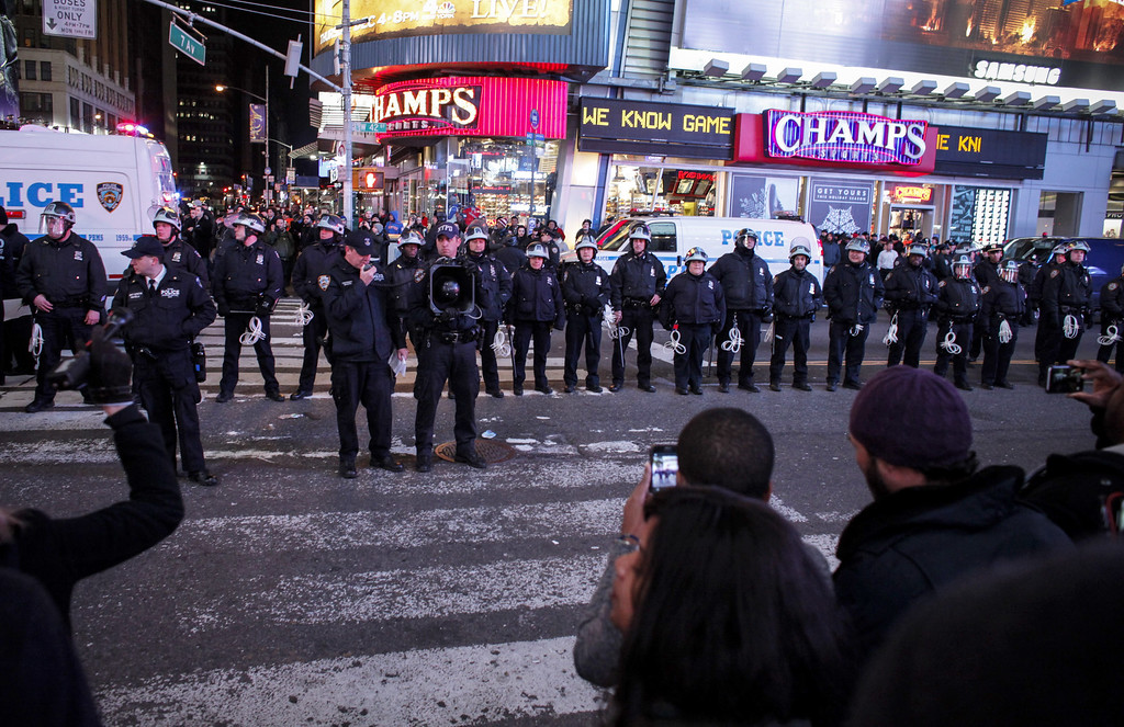 . New York City police block demonstrators on Times Square following yesterday\'s decision by a Staten Island grand jury not to indict a police officer who used a chokehold on Eric Garner, who subsequently died, on December 4, 2014 in New York City. The grand jury declined to indict New York City Police Officer Daniel Pantaleo over the death of Garner in July. (Photo by Kena Betancur/Getty Images)