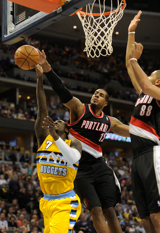 . DENVER, CO. - NOVEMBER 1:  Portland forward LaMarcus Aldridge (12) rejected an attempt by Denver forward J.J. Hickson (7) in the first half. The Denver Nuggets were defeated by the Portland Trail Blazers 113-98 Friday night, November 1, 2013 at the Pepsi Center.  The Nuggets are winless after two games. Photo By Karl Gehring/The Denver Post