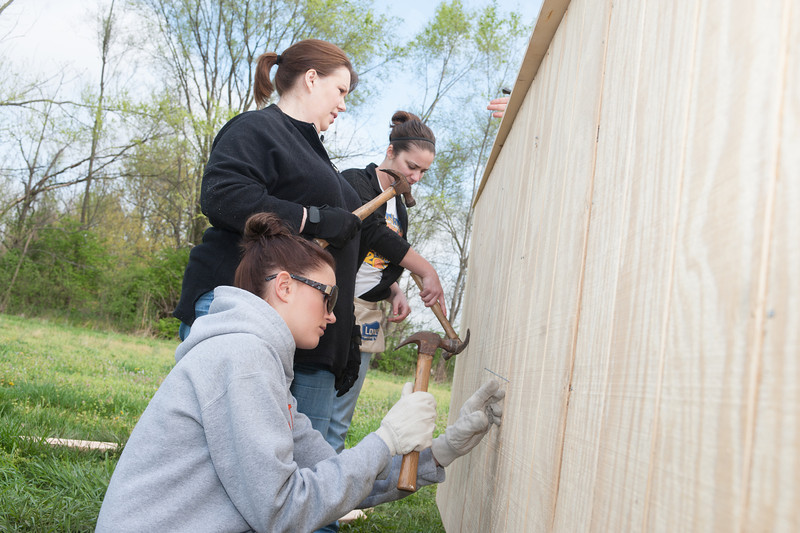 Mary Sterling design students work on a Habitat for Humanity shed on Chase Street in Terre Haute