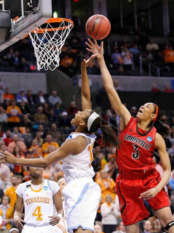 . Louisville center Sheronne Vails (3) goes up for a shot as Tennessee\'s Bashaara Graves (12) defends during the first half of the Oklahoma City regional final in the NCAA women\'s college basketball tournament in Oklahoma City, Tuesday, April 2, 2013.  (AP Photo/Alonzo Adams)