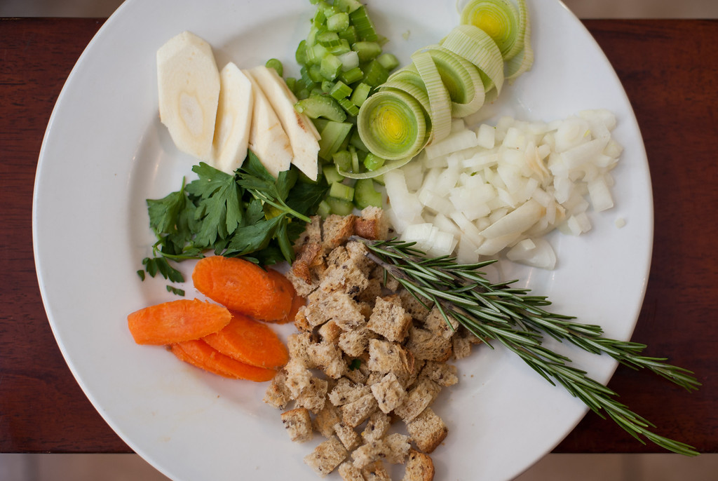 ". The basic ingredients for Thanksgiving stuffing are shown. Emma Currie said, ""If you want to experiment with the stuffing you can break the categories into three groups: first, the basics such as celery, onion, garlic, carrot; then the binders such as stock, cream or eggs; and then the add-ons like nuts, dried fruit, herbs and spices.\"" (Sun photo by Holly Mahaffey/@hollymahaffey)"