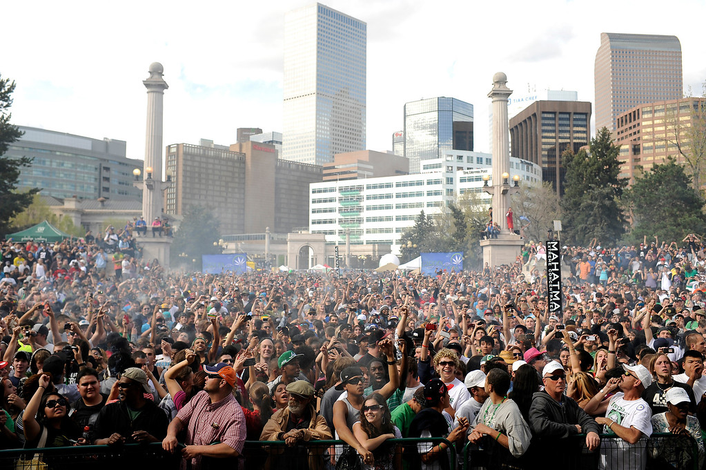 . A cloud of smoke covers the crowd at 4:20 p.m. at Denver 420 rally in Civic Center Park in Denver, Colo., on Friday, April 20, 2012. Hyoung Chang, The Denver Post
