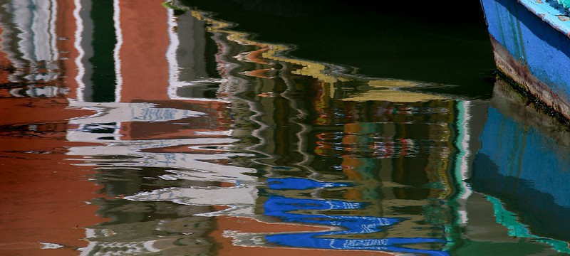 Building reflections in a canal