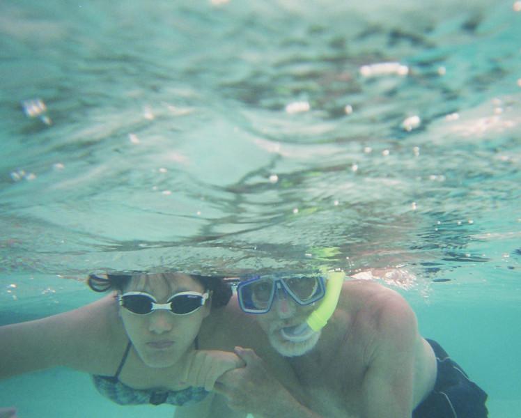 2004 June maldives dad mijung swimming underwater.jpg
