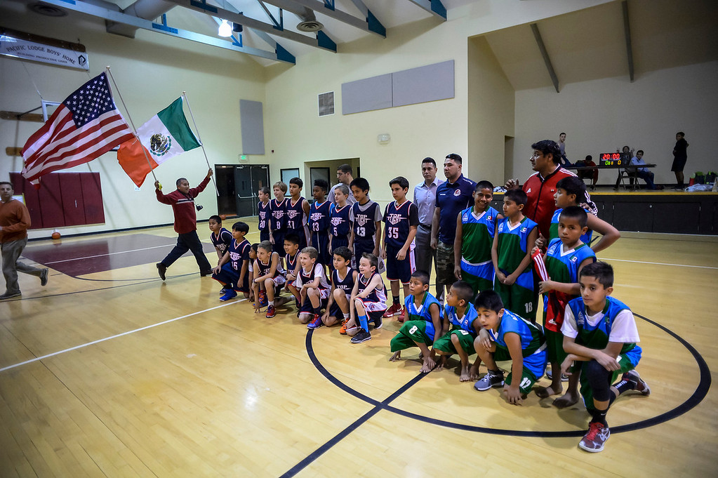 ". Triqui kids basketball team, from the mountainous region of Oaxaca, Mexico, who have been called the ""Barefoot Champions of the Mountain,\"" are known throughout their native Mexico for playing basketball without shoes took on the local Top Flight boys team at the Pacific Boys Lodge in Woodland Hills, CA Wednesday, December 18, 2013.  Before the game teams pose together for photos.  (Photo by David Crane/Los Angeles Daily News)"