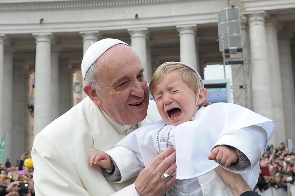 . In this picture provided by the Vatican newspaper L\'Osservatore Romano, 19-month-old Daniele De Sanctis, dressed up as a pope, is handed to Pope Francis as he is driven through the crowd during his weekly general audience in St. Peter\'s Square at the Vatican, Wednesday, Feb. 26, 2014. Francis kissed the child as the new must-have Carnival costume made its debut at the pope\'s general audience Wednesday. During Carnival in Italy, children often go to school and spend their weekends dressed up in pirate, princess and now pope costumes. Carnival, also known as mardi gras, marks the period before the church\'s solemn Lenten season begins. Daniele\'s mother, Paola Ciabattini, said she dressed her son as a pope in a demonstration of affection towards Pope Francis. (AP Photo/L\'Osservatore Romano, ho)