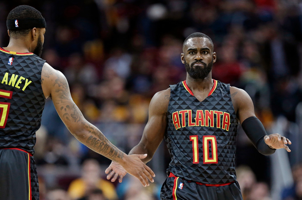 . Atlanta Hawks\' Tim Hardaway Jr., right, is congratulated by Malcolm Delaney after shooting a three-point basket in the second half of an NBA basketball game against the Cleveland Cavaliers, Friday, April 7, 2017, in Cleveland. (AP Photo/Tony Dejak)