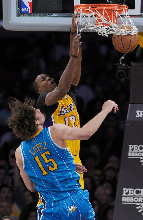 . Lakers#12 Dwight Howard gets past Hornets#15 Robin Lopez for a dunk in the 2nd quarter. The Lakers played the New Orleans Hornets at Staples Center in Los Angeles CA 4/9/2013(John McCoy/Staff Photographer