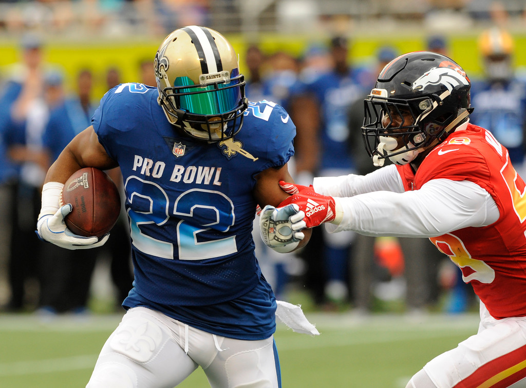 . AFC linebacker Von Miller (58), of the Denver Broncos, attempts to tackle NFC running back Mark Ingram (22), of the New Orleans Saints, during the first half of the NFL Pro Bowl football game, Sunday, Jan. 28, 2018, in Orlando, Fla. (AP Photo/Steve Nesius)