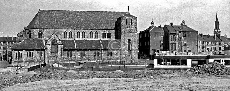 St Mungo again, with the Martyrs' School. Some tenements in Martyr St. on the left and Barony St. on the right. The present St Mungo's Primary is under construction.   April 1973