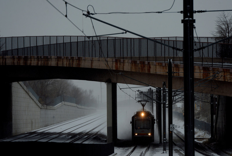 . A train arrives at the light rail station in downtown in Littleton, CO April 09, 2013. A winter storm has blown into northeastern Colorado, with strong winds and below-freezing temperatures creating blizzard-like conditions at times. (Photo By Craig F. Walker/The Denver Post)
