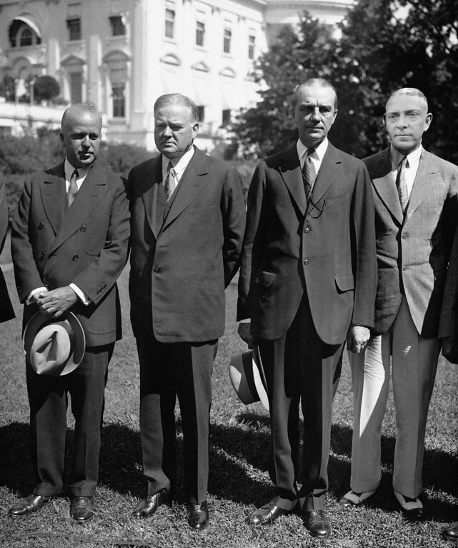 . 1929: Owen D. Young. U.S. President Herbert Hoover, center, with Walter S. Gifford, left, chairman of the National Unemployment Committee, and Owen D. Young, are seen on the grounds of the White House, Washington, D.C., on Sept. 18, 1931, when they met with business leaders of the nation to discuss plans for unemployment relief during the winter. (AP Photo)