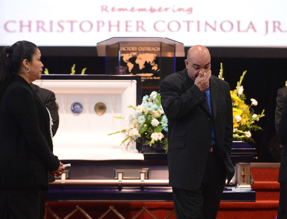 . Chris Cotinola Sr. walks away from his son, Chris Cotinola Jr\'s, casket during a funeral for the young man in Chino March 21, 2013. Chris Cotinola Jr., the 20-year-old Pomona man who was shot and killed outside his Gordon Street apartment March 10.  (Staff photo/Inland Valley Daily Bulletin)