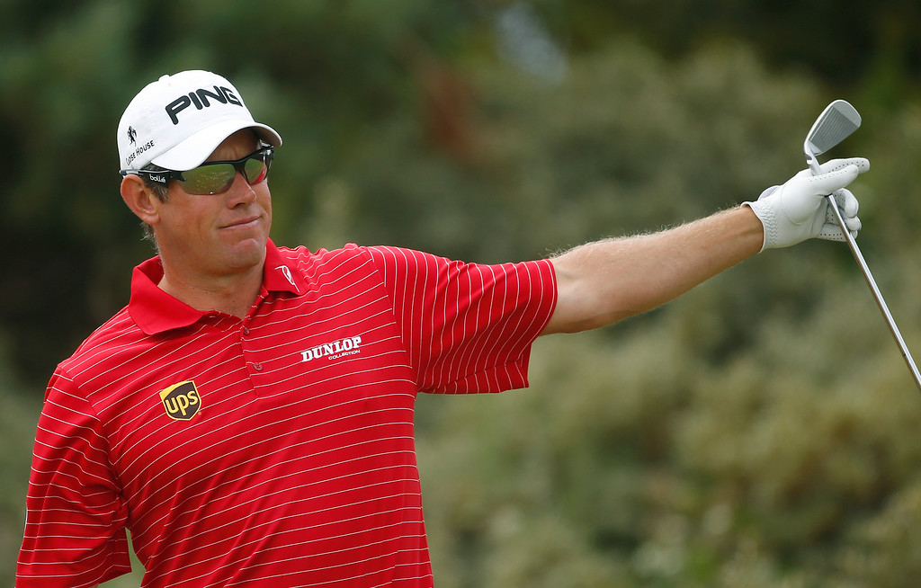 . Lee Westwood of England gestures after playing off the third tee during the final round of the British Open Golf Championship at Muirfield, Scotland, Sunday July 21, 2013. (AP Photo/Peter Morrison)