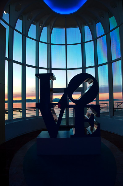 """A """"LOVE"""" sculpture on our cruise ship """"Millennium"""" with the sunset in the background."""