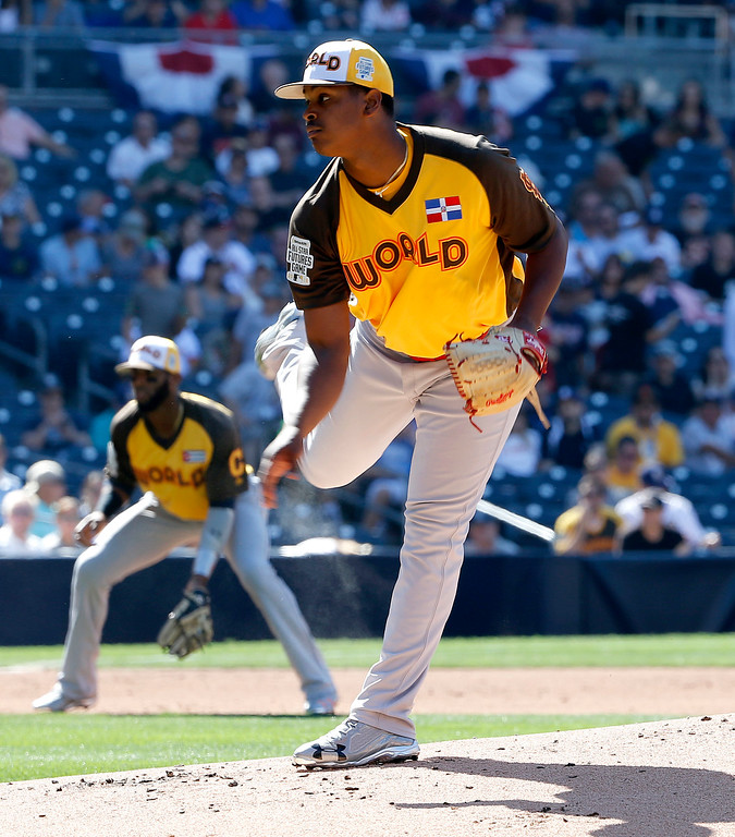 . World Team starting pitcher Alex Reyes, of the St. Louis Cardinals, throws against the U.S. Team during the first inning of the All-Star Futures baseball game, Sunday, July 10, 2016, in San Diego. (AP Photo/Lenny Ignelzi)