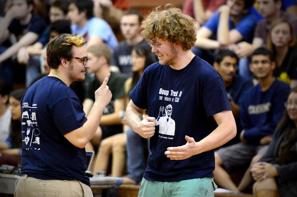 ". The Cunning Stunts Harrison Miller and Joseph Greef share a moment before a round as mechanical engineering Caltech students compete in the annual ME72 Engineering Design Contest at the Pasadena campus Tuesday, March 11, 2014. The goal in ""Raiders of the Lost Can\"" was to move their team\'s can closest to the center of a platform. (Photo by Sarah Reingewirtz/Pasadena Star-News)"