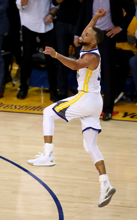 . Golden State Warriors guard Stephen Curry celebrates during the second half of Game 1 of basketball\'s NBA Finals between the Warriors and the Cleveland Cavaliers in Oakland, Calif., Thursday, May 31, 2018. (AP Photo/Ben Margot)