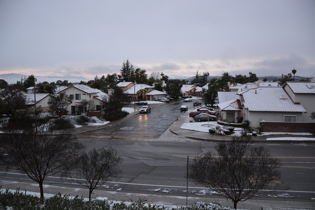 . Snow on the rooftops of a Murrieta, California neighborhood following a storm that dropped several inches of snow across the Inland Empire. (Photo courtesy of Jerry Rice)