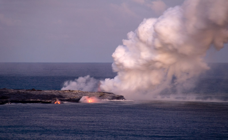 Lava pouring into the ocean at dusk, Big Island, Hawaii
