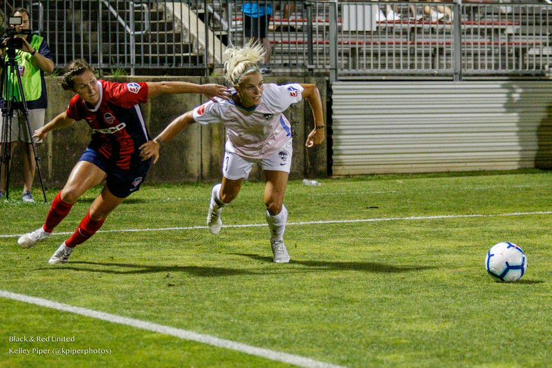 Washington Spirit midfielder Jordan DiBiasi (4) and Houston Dash forward Rachel Daly (3) challenge to get to the ball at Maureen Hendricks Field in Boyds, MD, on July 20, 2019.