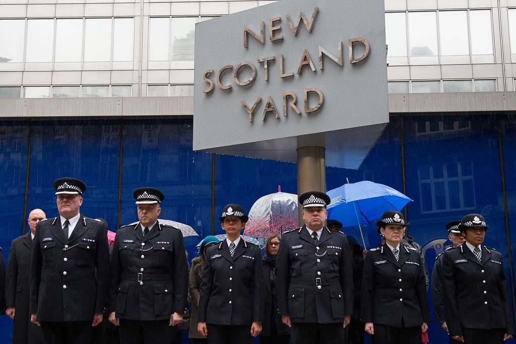 . Deputy Commissioner of Britain\'s Metropolitan Police Craig Mackey (Front Row 3rd R) leads police officers in a two minute silence outside Scotland Yard in London, on January 8, 2015, to show their respect for all those murdered in Wednesday\'s terrorist attack in Paris, including two police officers. Seven people have been detained in the hunt for brothers suspected of gunning down 12 people in an Islamist assault on a satirical weekly, a French judicial source said Thursday. AFP PHOTO / LEON NEAL/AFP/Getty Images