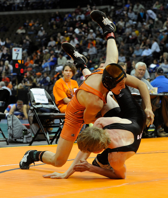. DENVER, CO. - FEBRUARY 21: Burlington wrestler Gaston Hornung flipped Yuma\'s Luke Brown in a 132-pound weight division in class 2A. The CHSAA State Wrestling Tournament kicked off Thursday, February 21, 2013 at the Pepsi Center in Denver.   (Photo By Karl Gehring/The Denver Post)