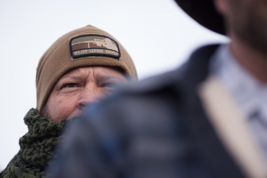 . Members of a group of armed anti-government protesters listen as Ammon Bundy speaks to the media at the Malheur National Wildlife Refuge near Burns, Oregon January 4, 2016. The FBI on January 4 sought a peaceful end to the occupation by armed anti-government militia members at a US federal wildlife reserve in rural Oregon, as the standoff entered its third day. The loose-knit band of farmers, ranchers and survivalists -- whose action was sparked by the jailing of two ranchers for arson -- said they would not rule out violence if authorities stormed the site, although federal officials said they hope to avoid bloodshed. AFP PHOTO / ROB KERRROB KERR/AFP/Getty Images