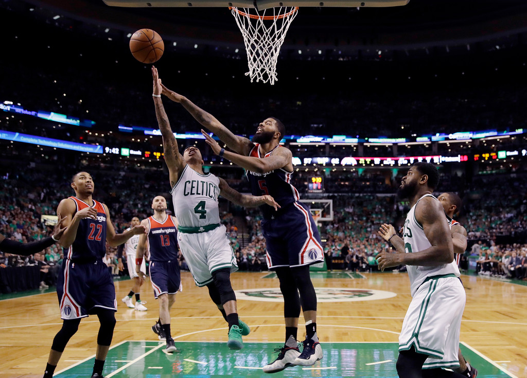 . Boston Celtics guard Isaiah Thomas (4) drives against Washington Wizards forward Markieff Morris (5) during the fourth quarter of Game 7 of a second-round NBA basketball playoff series, Monday, May 15, 2017, in Boston. (AP Photo/Charles Krupa)
